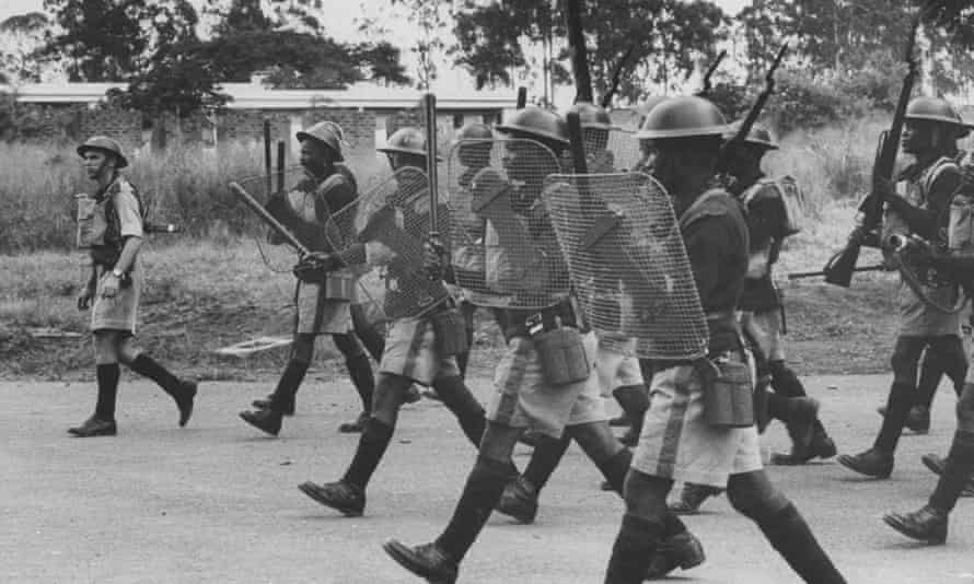 British colonial forces charge at a group of rioters in former Nyasaland in 1959.