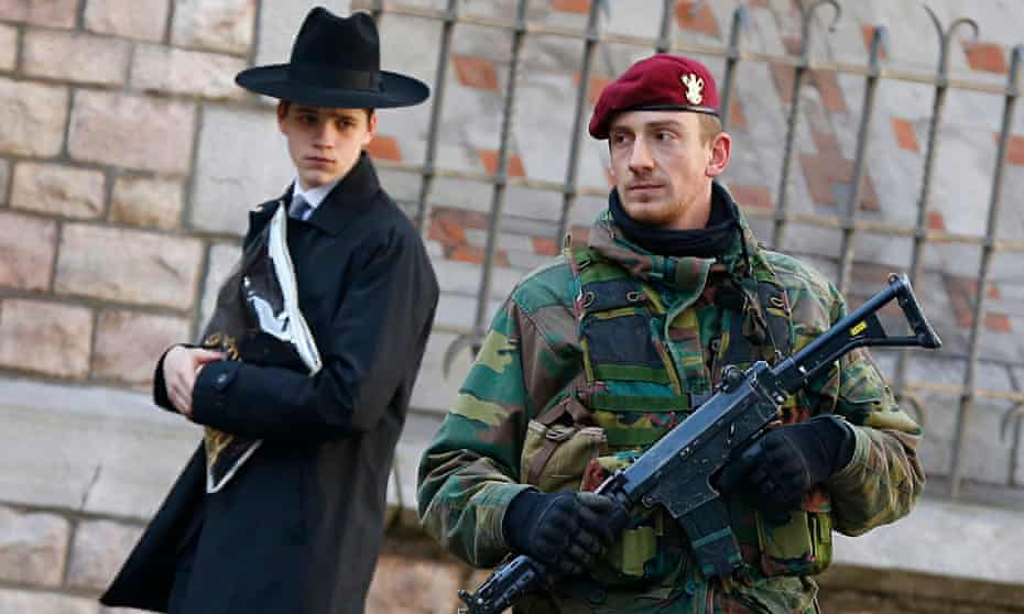A Belgian paratrooper keeps guard outside a Jewish school in central city of Antwerp