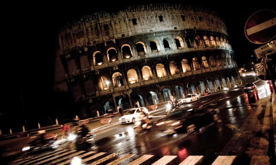 the Roman Colosseum by night.