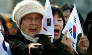 North Korean defectors demonstrate against their former homeland in Seoul.