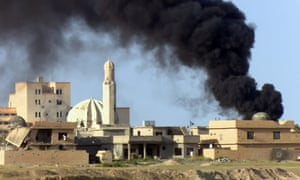 Smoke rises from a building during fighting between Iraqi army and Islamic State militants in Tikrit