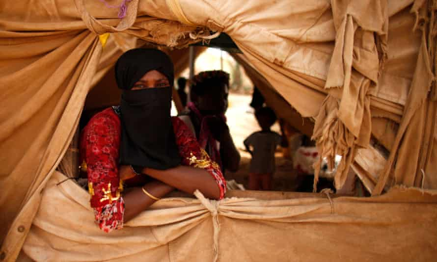 A woman looks from a window of her family's tent in al-Mazraq in 2013.