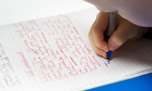 UK Primary school child writes in an exercise book