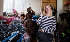 Victims of the housing crisis… Stacey Thomas with her family in their one-room-home at England's La