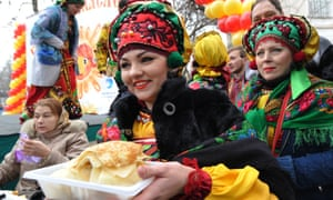 A woman holds plate of pancakes to mark the end of Maslenitsa (Shrovetide) in Kyrgyzstan's capital Bishkek last month.