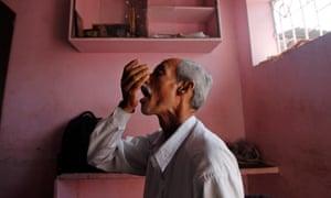 A TB patient in Mumbai takes medicines.