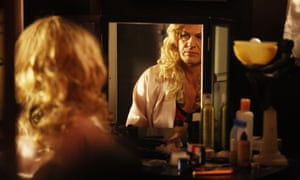Sean Bean as Tracie Tremarco, a character based on Roger Hill's alter ego Mandy Romero.