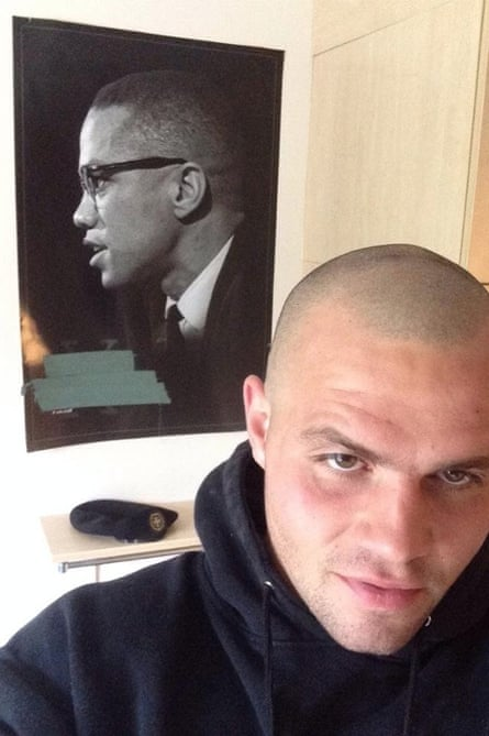 Scurfield with a poster of Malcolm X