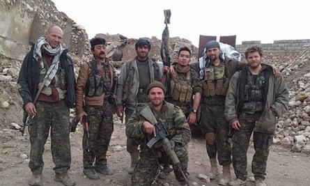 Kurdish and foreign fighters including British citizen Konstandinos Erik Scurfield, foreground in Sinjar, Iraq