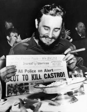 "1959, Manhattan, New York. Seeming quite amused, Castro, now Cuban Prime Minister, holds up a newspaper headlining the discovery of a plot to kill him. Police said five brothers had been sent to New York from Philadelphia to assassinate him. When asked about a reported assassination attempt, Castro had replied, ""In Cuba, they had tanks, planes and they run away. So what are they going to do here? I sleep well and don't worry at all."""