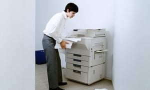 Young man using photocopier