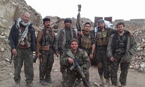 Kurdish fighters and foreign volunteers fighting against Isis, with Konstandinos Erik Scurfield in the foreground.