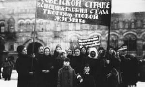 Russian women workers visit Lenin's tomb in 1925.