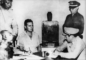 Castro is questioned by police and military officials at the Vivac prison in Santiago de Cuba after he and some 140 rebels attacked the federal garrison at Moncada, the first armed action of the Cuban Revolution in 1953