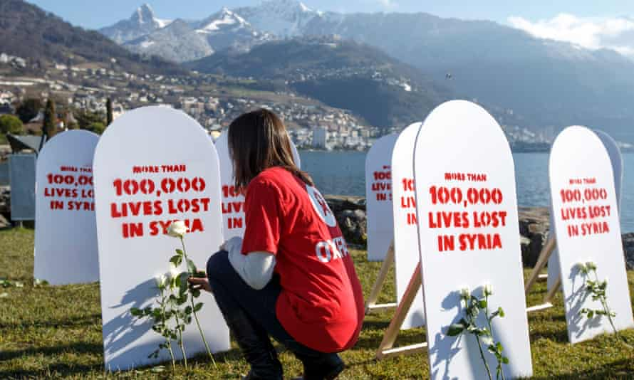 An Oxfam member during the 2014 Geneva peace talks on Syria.