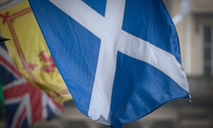 Scottish Saltire with the Welsh and Union flags in the background