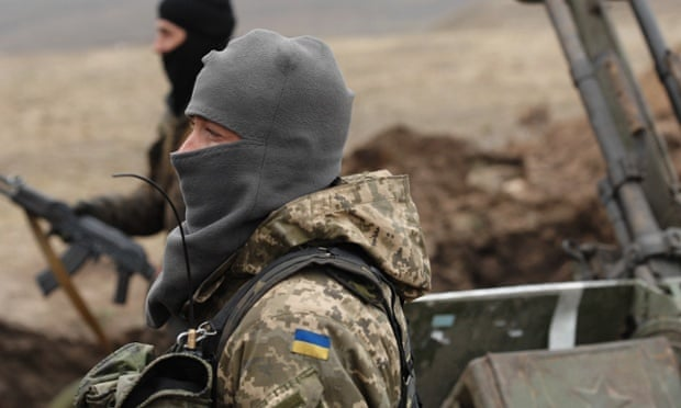 Ukrainian government soldiers dig trenches east of the port city of Mariupol.