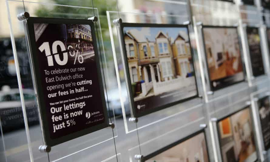 Promotional signs hang in a window of Jackson's estate agents in south London.