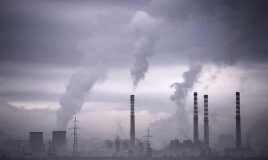Water vapour from power stations in Europe. Limits on emissions from power plants have been weakened due to industry lobbying, says Greenpeace.
