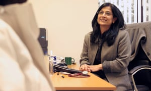 Dr Veena Jha with a patient at Manor House GP surgery in Glossop.