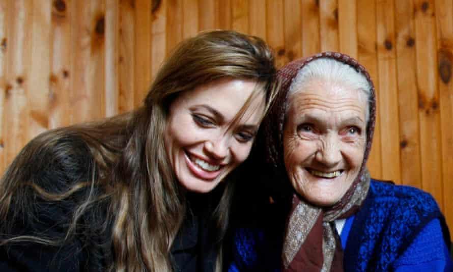 Angelina Jolie shares a laugh with Bosnian woman Babic Lena.