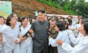 North Korean leader Kim Jong-un visits a mushroom farm in 2013.