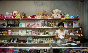 A North Korean woman works as a shopkeeper in a knick-knack shop located in Pyongyang.