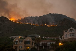 Fire burns above homes in Muizenberg, Cape Town, South Africa
