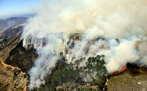 Firefighters battle a blaze at Hout Bay. Fires that broke out in Muizenberg on Sunday have spread to further parts of the Southern Peninsula