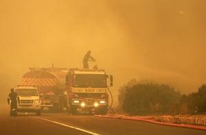 Firefighters battle a blaze on Chapman's Peak