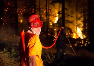 Firefighters tackle a blaze raging in the Tokai forest