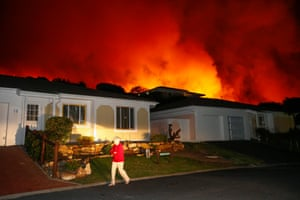 The fire approaches homes. Residents in some areas were forced to evacuate