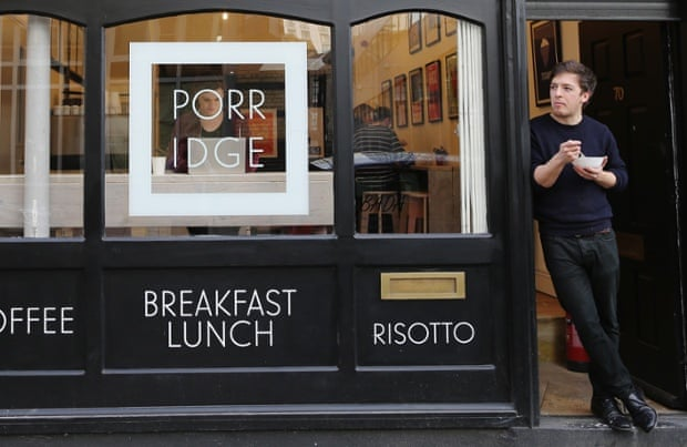 Cafe owner Nik Williamson eats a bowl of porridge at the 'Porridge Cafe' in Shoreditch on March 2, 2015 in London, England. The Porridge Cafe is the first of its kind to open in London. (Photo by Dan Kitwood/Getty Images)Human InterestBusinessFinanceRetail
