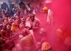 People celebrate Lathmar Holi at Barsana in Uttar Pradesh. In a Holi tradition unique to Barsana, men sing provocative songs to gain the attention of women, who then beat them with bamboo sticks called lathis