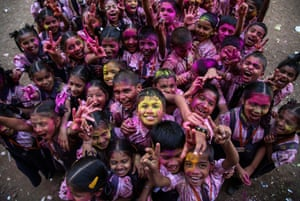 Schoolchildren pose during Holi festival celebrations at a school in Ghodbander near Mumbai