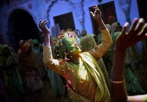 A widow dances at a widows' ashram at Vrindavan in Uttar Pradesh
