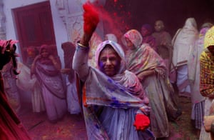 A widow throws coloured powder in Vrindavan