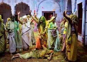 Widows chant religious hymns a widows' ashram at Vrindavan