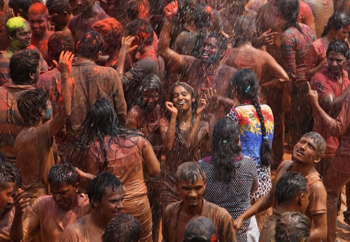 A crowd dances in artificial rain in Hyderabad,