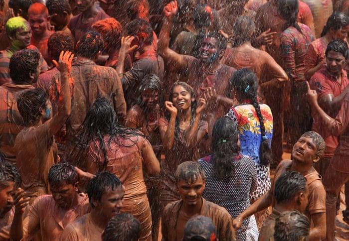 A crowd dances in artificial rain in Hyderabad,