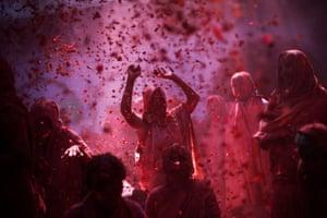 Widows chant religious hymns and throw flower petals at a widows' ashram at Vrindavan
