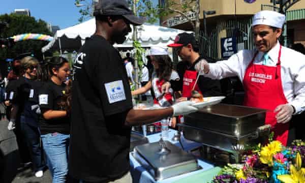 Ex-LA mayor Antonio Villaraigosa serves lunch at the Los Angeles Mission easter celebration in Skid Row.