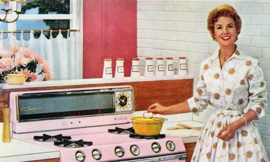 Fifties housewife with new pink gas range