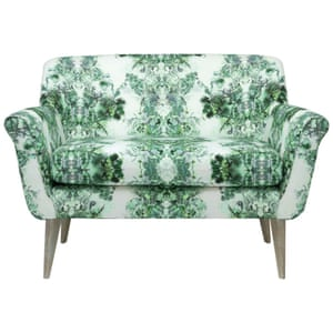 green and white patterned armchair