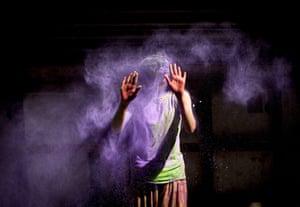 A boy takes part in the Holi festival in Calcutta, India