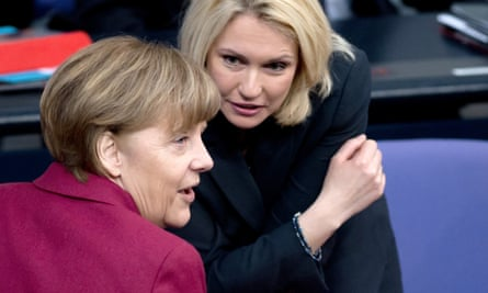The German chancellor, Angela Merkel, talks to and women's minister Manuela Schwesig during a parliamentary session on Friday