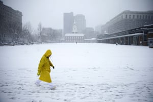 A man walks past Independence Hall during a snow storm in Philadelphia