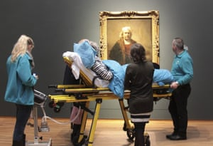 A terminally ill woman looks at a self portrait of Rembrandt at the Rijksmuseum