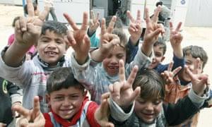 Syrian children in Jordan's Zata'ari refugee camp, where 46,775 children now live.