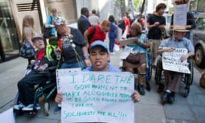 People with disabilities protest outside the Department of Work and Pensions, London.
